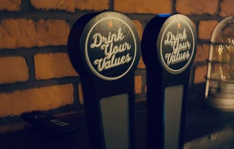 close up of DYV social justice beer tap at The Battleground social justice taproom Kent ohio
