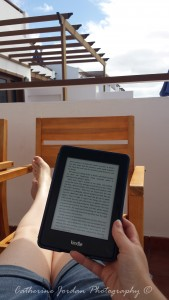 Enjoying the sunshine with my Kindle.