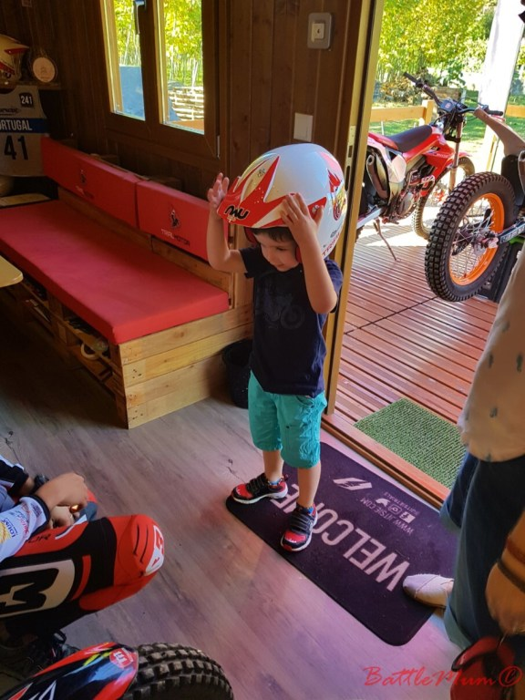 BattleKid trying on a helmet for size.
