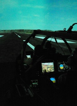 Pilots will experience hi-def graphics and full-motion training in the Marine Corps' new flight simulators for its growing inventory of updated UN-1Y Huey and the AH-1Z Super Cobra helicopters. (Photo by Gidget Fuentes)