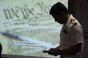 A military PowerPoint presentation in its natural habitat. (Photo by Greg Vojtko/Navy)