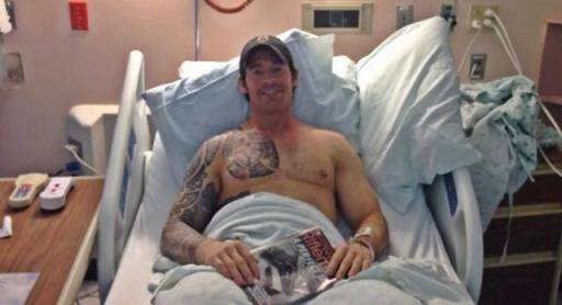 Former SO1 Chris Heben in his hospital bed after a March 28 parking lot shooting. (Photo via Facebook)