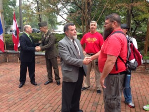 Doolittle shakes hands with Danny Joy, a Marine veteran and survivor of the Beirut bombings. Photo courtesy Doolittle's Facebook page
