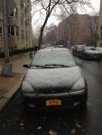 The First Snow barely stuck to the car.