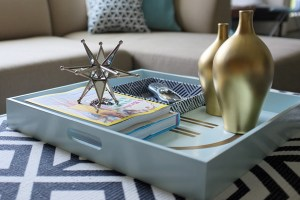 Well-styled tray placed on ottoman