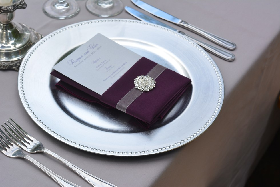 Each place setting was adorned with a crystal brooch...