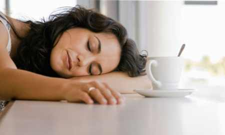 Tired woman sleeping on counter