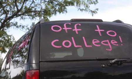 Off to College written on the back of SUV