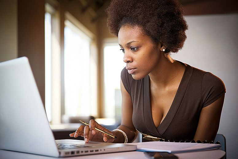 Black Women Looking At Computer