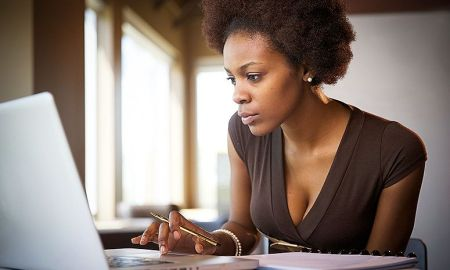 Black Women Looking At Computer