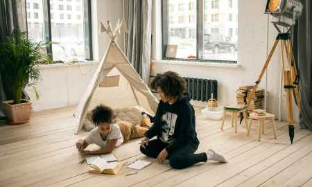 Black woman doing homework with daughter