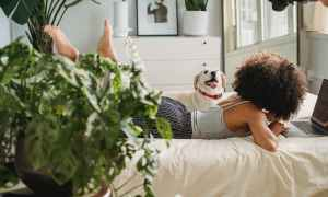 Black woman relaxing on bed
