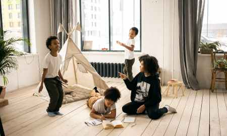 Black mother playing with her children at home