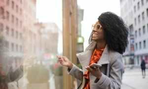 Black woman on street laughing