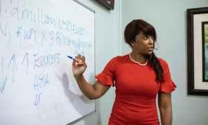 Black woman teaching with whiteboard