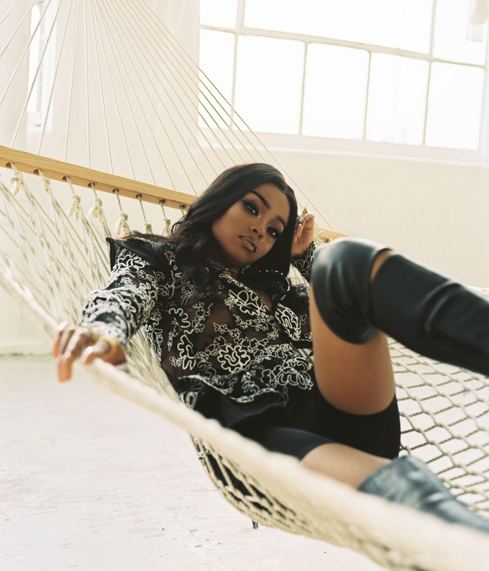 Maliibu Miitch lying in a Hammock