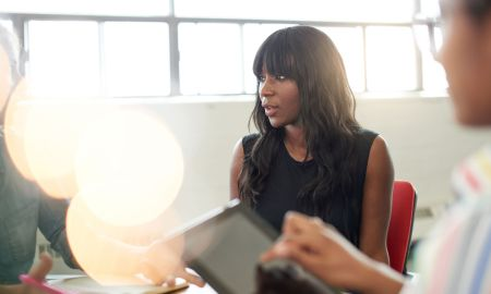 black businesswoman talking in meeting