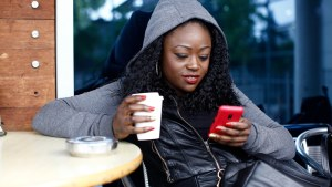 black woman looking at cell phone