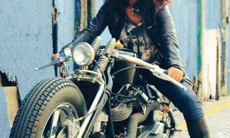 black woman riding motorcycle bike