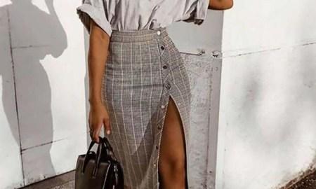 black girl fashion holding leather bag