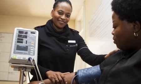 black woman working as nurse