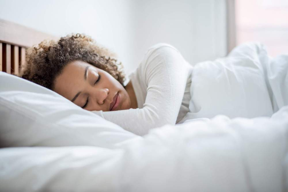 feel good by sleeping this black woman asleep in bed