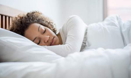 black woman asleep in bed