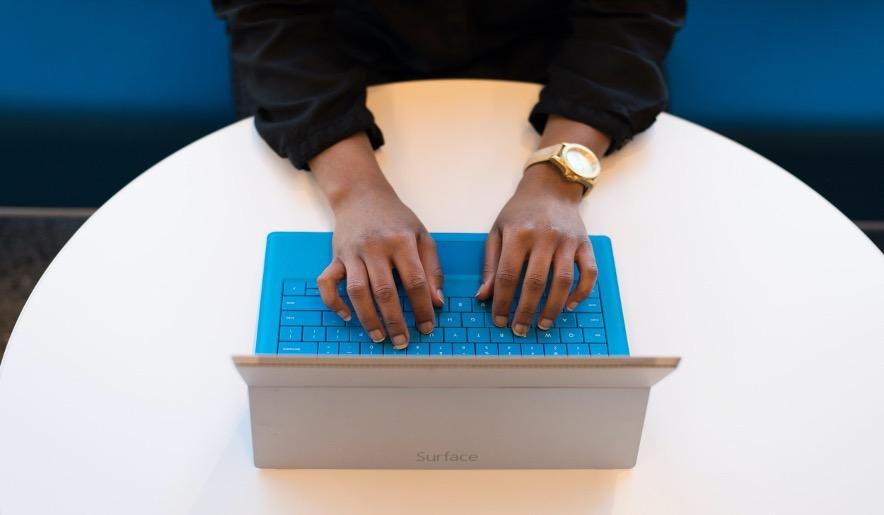 black woman typing software developer