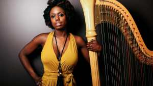 black woman with harp