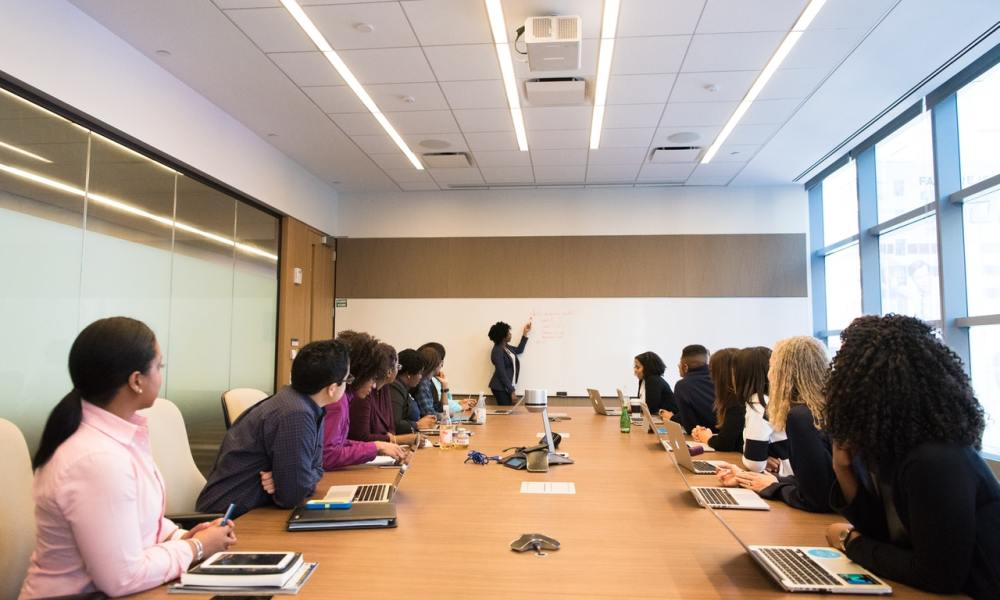 african american woman leading team meeting