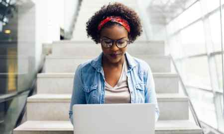 young black female college student researching on computer