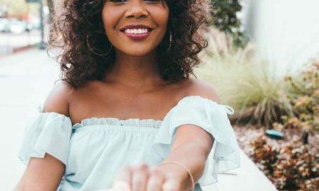 black woman holding hand