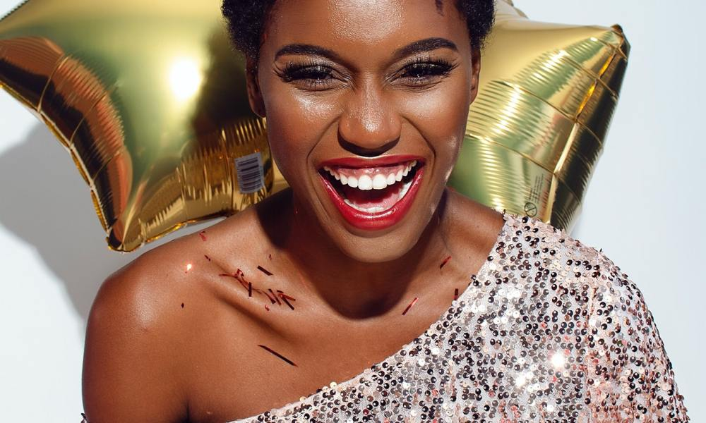 black woman smiling with no crooked teeth