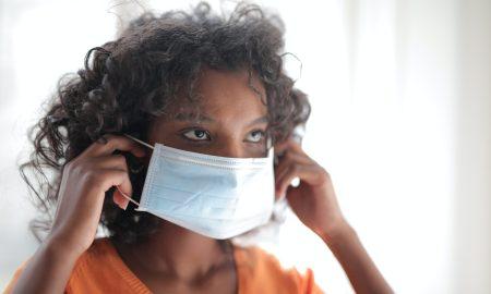 black woman wearing face mask