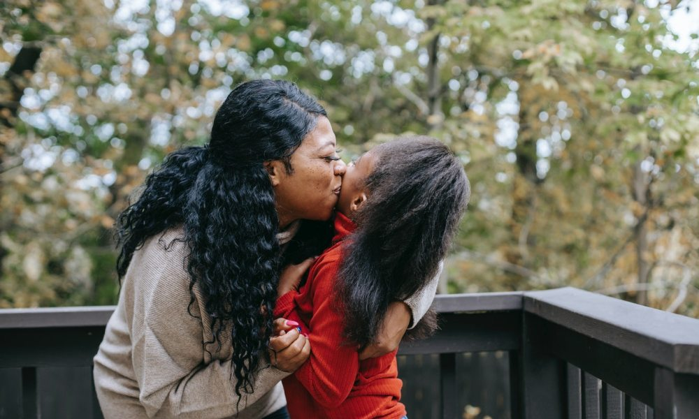 black mom hugging child with special needs