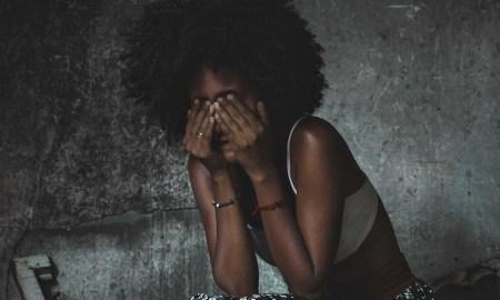 black woman headache in pain