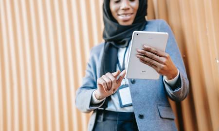black woman on ipad ethnic muslim