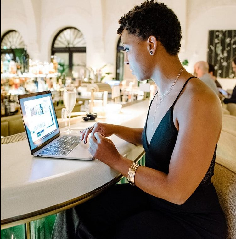 black woman working on fba business listings