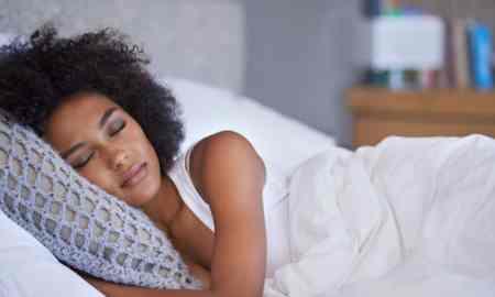 black woman sleeping in bed sleep