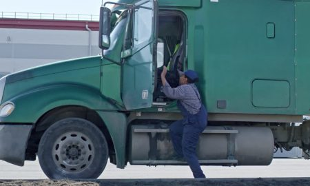 Black woman driving a truck