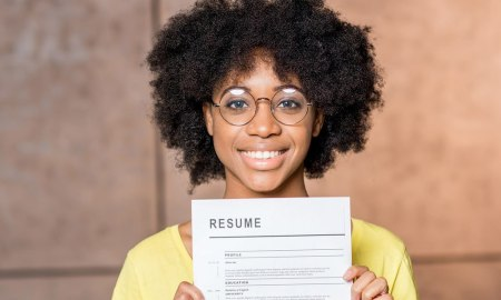 Black woman holding resume