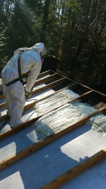 Applying Spray Foam Insulation from the Outside - applying spray foam