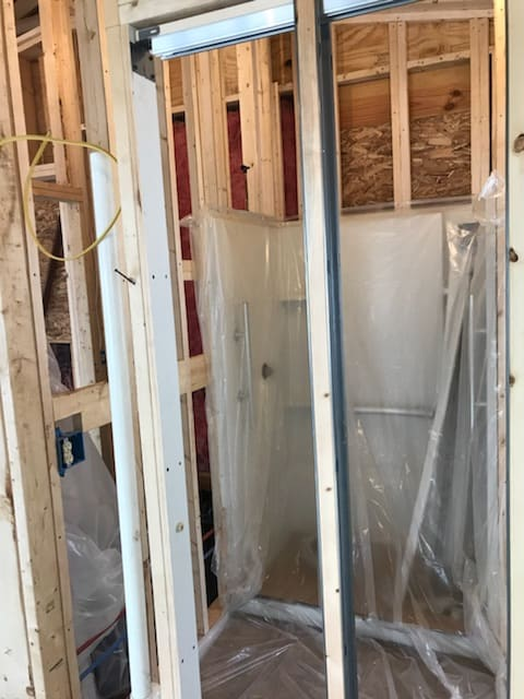 Using Spray Foam for a Country Home - bath tub protection with plastic