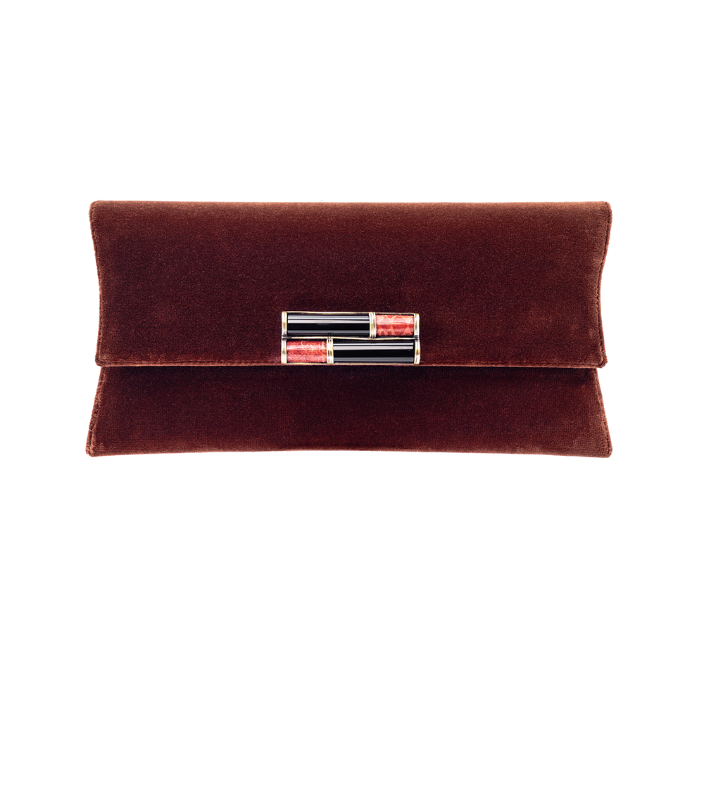 The Lila Clutch is handcrafted in Portugal out of velvet and lined with black suede on the inside.