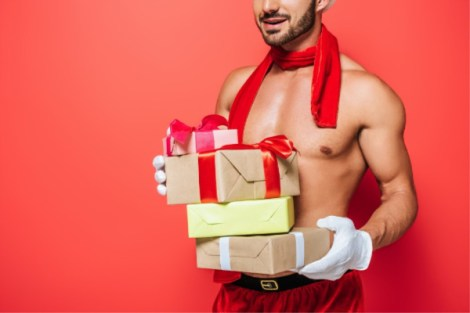 Sexy man holding gifts