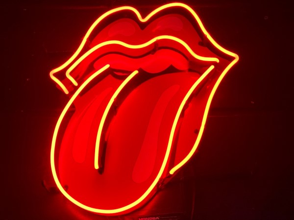 Neon light of lips and tongue