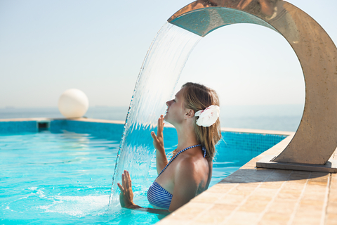 Attractive young woman refresh in pool