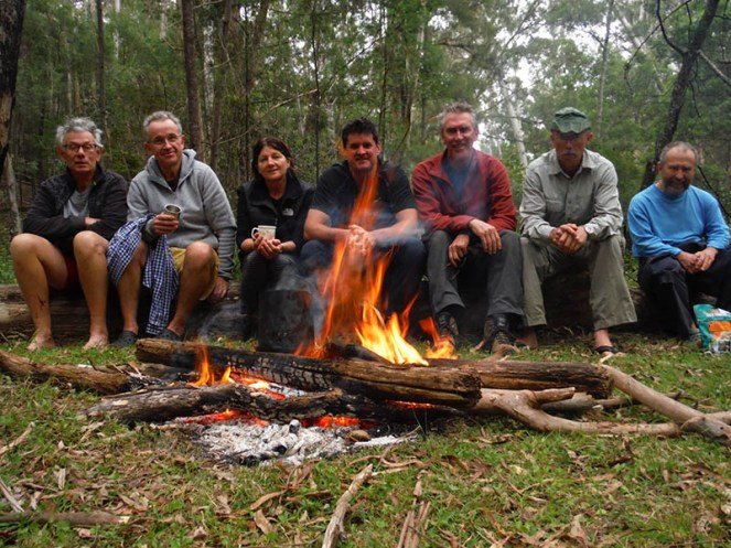 L to R: Ian, Mark, Wendy, Simon, Brian, Martin, David around the camp fire