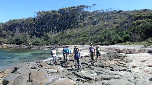Walkers on rock platform near Snake Bay