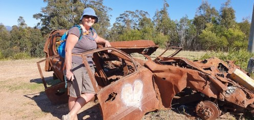 Donna and an old car wreck